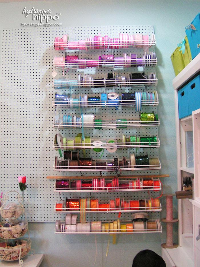 Peg Board wall and ribbon storage racks in Jennifer Priest's Scrapbook Room.