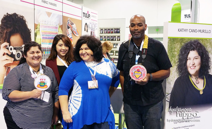 Xaver and I with our hoop art with Crafty Chica and Maya In The Moment at the ilovetocreate booth!