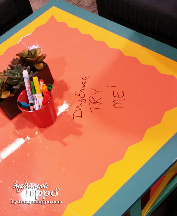 Krylon Dry Erase Spray Paint on a coffee table at CHA 2015.