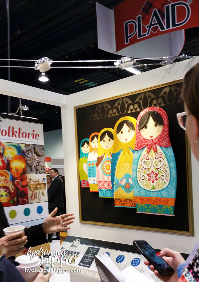 Painted matryoshka dolls in the PLAID booth, showing off their different finishes and decorative painting techniques.
