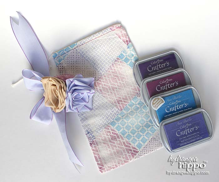 Create a Pretty Faux Quilted Gift Bag to welcome a guest with Clearsnap ColorBox Crafter's Ink and ColorBox Background Basics stamps byAnn Butlder Designs.