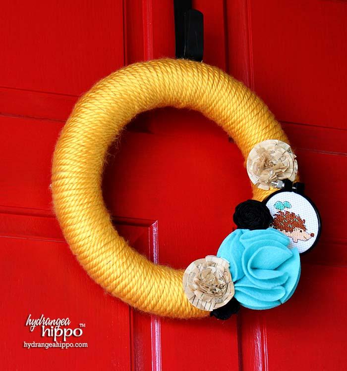 Easy Yarn Wreath with Bernat Chunky Yarn and Cross Stitch Hedgehog by Jennifer Priest