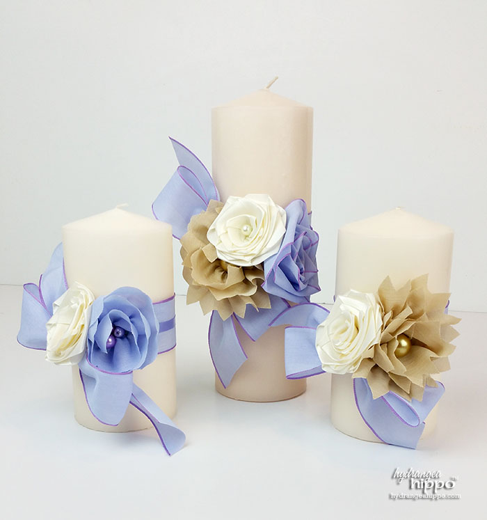 Make a batch of handmae ribbon flowers first. Then mix and match them to make each candle wrap unique.