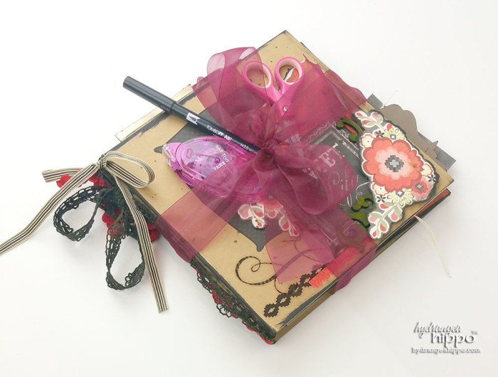 Include adhesive, scissors, and a journaling pen with a scrapbooking ift to make it easy for the recipient to actually USE it!