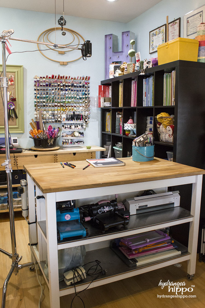 Craft Room Tour 2015 - Smart Fun DIY. Keep larger tools on tables at the ready. Store tools you use less often on shelving, like the serger sewing machine on the bottom shelf of a work table in this photo