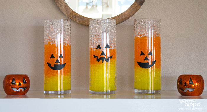 Candy Corn Vases with Jack-O-Lantern Faces! Halloween Decor is easy with GEMNIQUE Water Beads. See how to make this display for under $15! [AD]