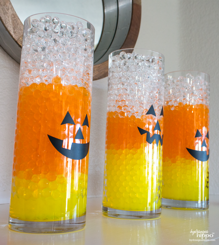 Halloween Decor is easy with GEMNIQUE Water Beads. Make this candy corn vase display for under $15! [AD]